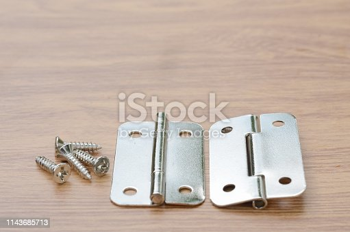 istock Tools and auto spare parts on a wooden work  bench surface. 1143685713