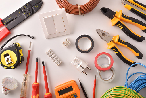 istock Tools and electrical material on a white table top general 1129160928