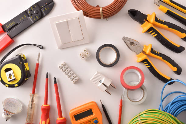 Tools and electrical material on a white table top general Tools and electrical material on a white table general view Horizontal composition. Top view. material stock pictures, royalty-free photos & images