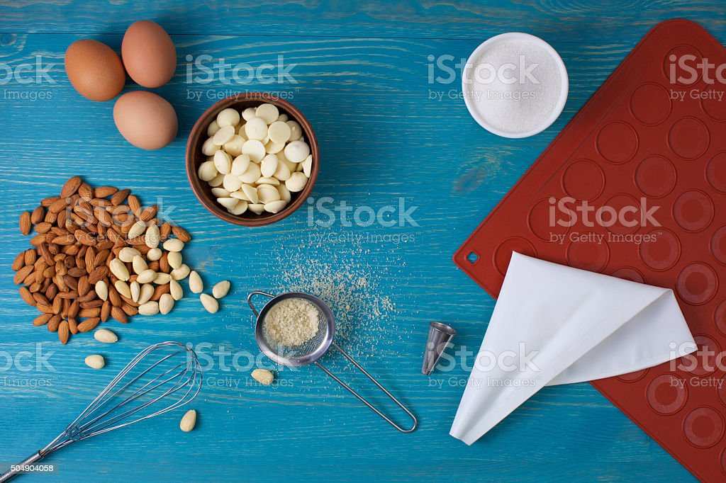 tools and ingredients for making macaroons stock photo