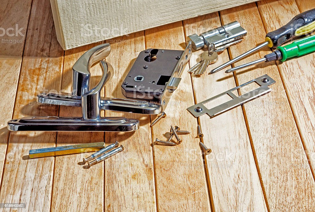 Tools and mortise lock before installing the door. stock photo