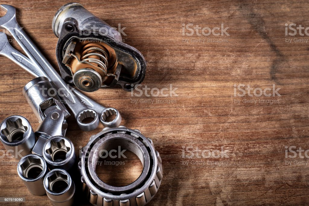 tools and old auto parts on wooden background stock photo