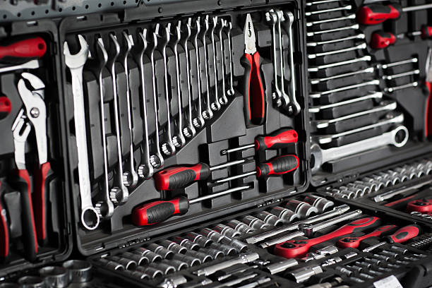 Tools and toolbox on shop (store) showcase Red tools and black toolbox on the shop (store) showcase. Many wrench and nuts in toolkit sets socket wrench stock pictures, royalty-free photos & images