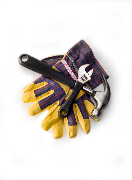 Tools and working gloves  on white stock photo