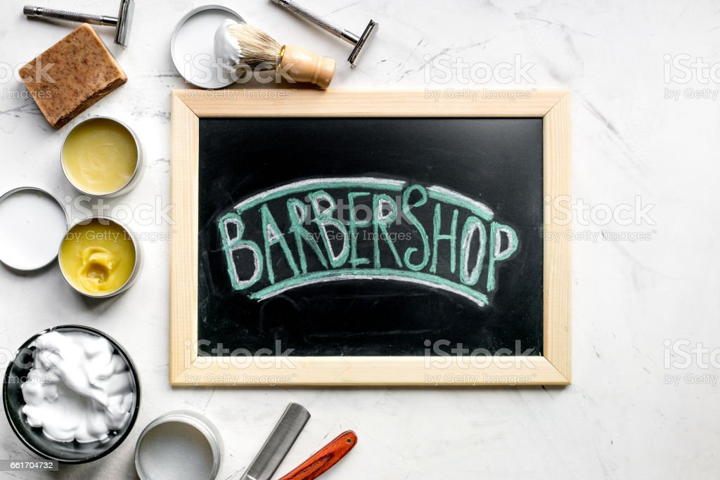 Tools for cutting beard in barbershop on workplace background top view stock photo