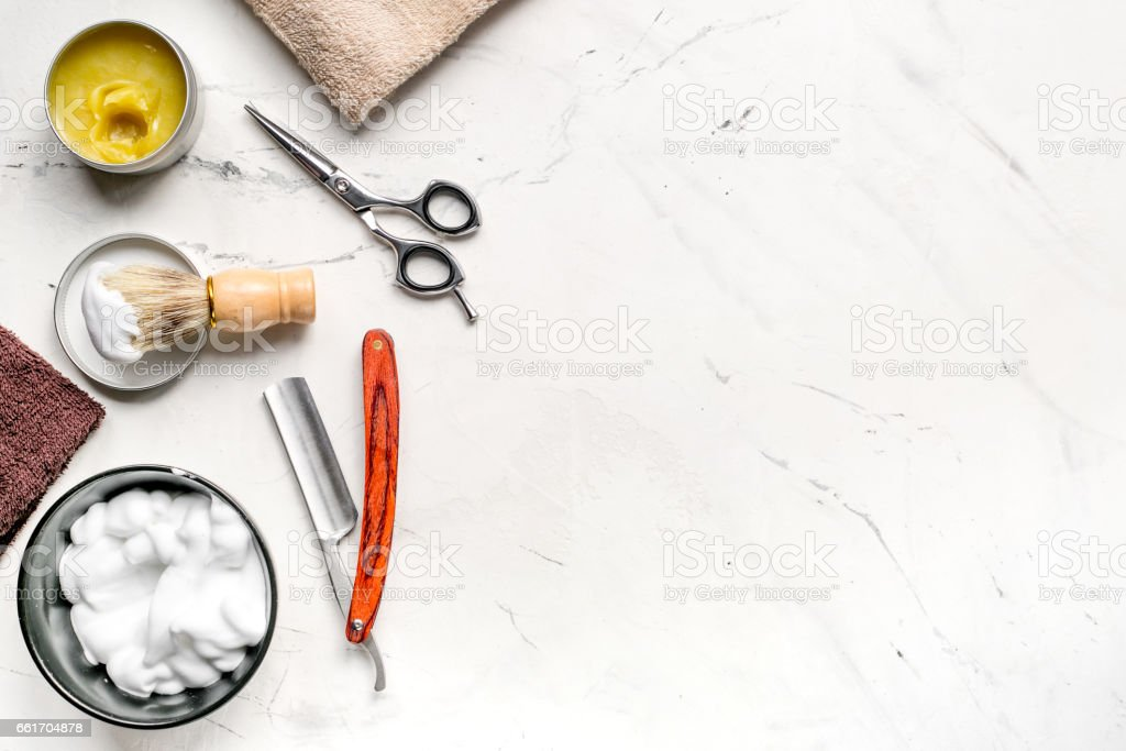 Tools for cutting beard in barbershop on workplace background top view mockup stock photo