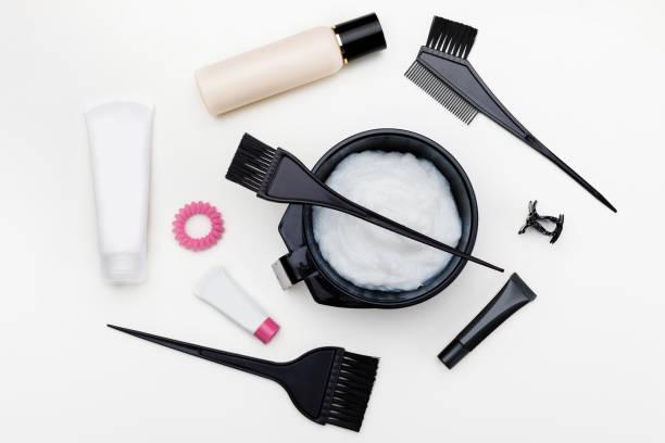 tools for hair dye - capelli ossigenati foto e immagini stock