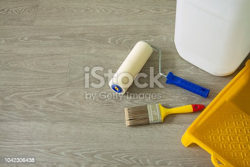 istock Tools for priming plastered surfaces for further painting. 1042306438