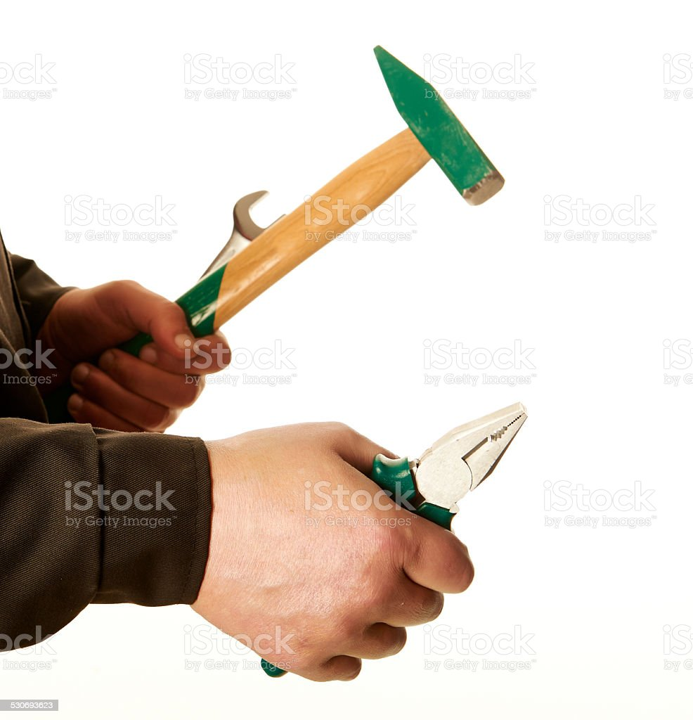 Tools for repair, pliers, hammer, wrench, worker hands, white background. stock photo