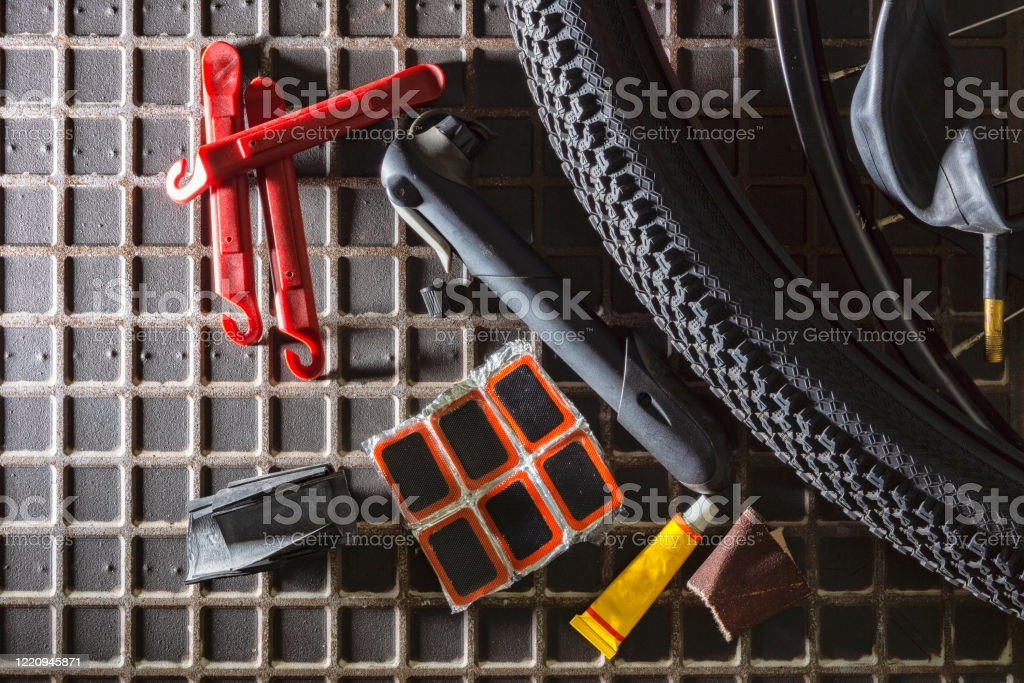 Tools for repairing leaky bicycle cameras Tools for gluing bicycle cameras Adhesive Bandage Stock Photo