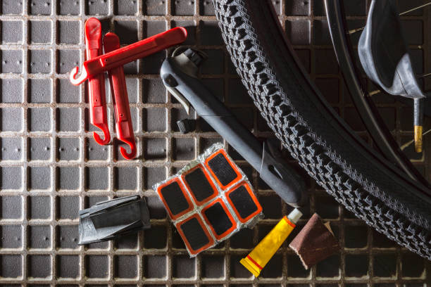 Tools for repairing leaky bicycle cameras stock photo