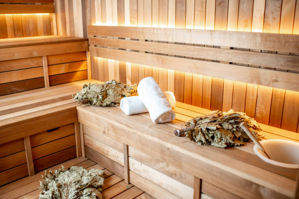 Tools for steaming in russian sauna Bath brooms with towels on the bench at the russian traditional sauna sauna stock pictures, royalty-free photos & images