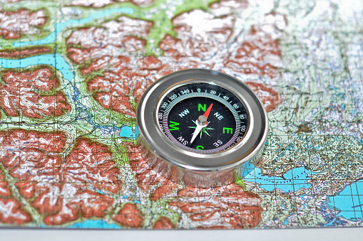 97623256 istock photo Tools for the journey - map and compass. 523050086