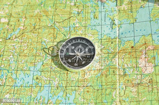 97623256istockphoto Tools for the journey - map and compass. 523050138