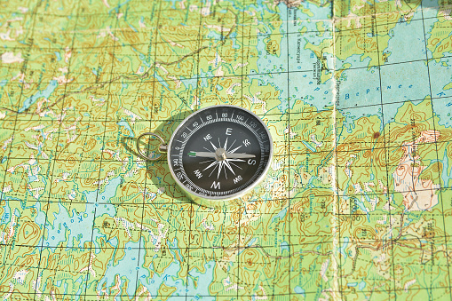 97623256 istock photo Tools for the journey - map and compass. 523050138
