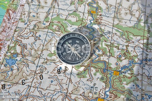 97623256istockphoto Tools for the journey - map and compass. 523050180