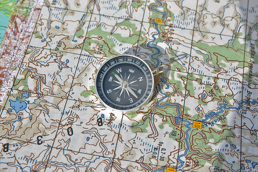 97623256 istock photo Tools for the journey - map and compass. 523050180