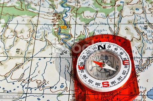 97623256istockphoto Tools for the journey - map and compass. 523050286