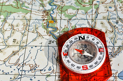 97623256 istock photo Tools for the journey - map and compass. 523050286