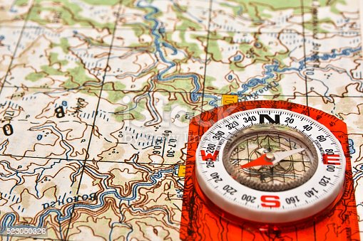 97623256istockphoto Tools for the journey - map and compass. 523050326