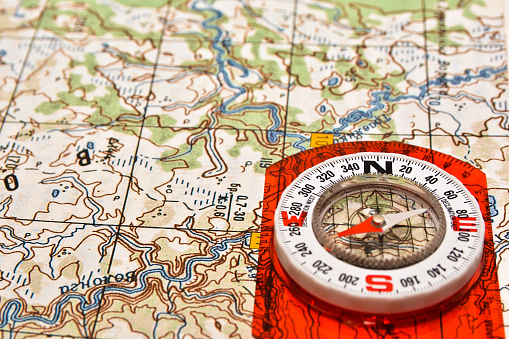 97623256 istock photo Tools for the journey - map and compass. 523050326