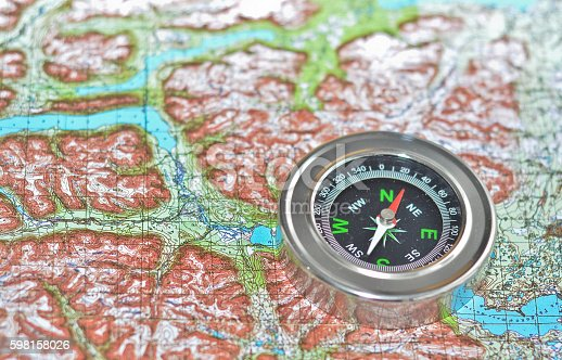 97623256istockphoto Tools for the journey - map and compass. 598158026