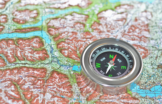 97623256 istock photo Tools for the journey - map and compass. 598158026