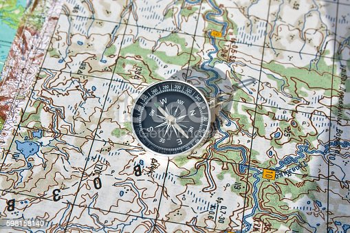 97623256istockphoto Tools for the journey - map and compass. 598158140