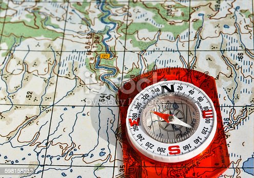 97623256istockphoto Tools for the journey - map and compass. 598158232