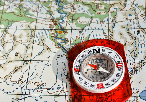97623256 istock photo Tools for the journey - map and compass. 598158232