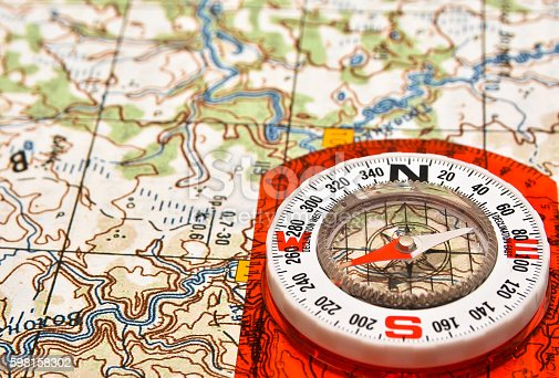 97623256istockphoto Tools for the journey - map and compass. 598158302