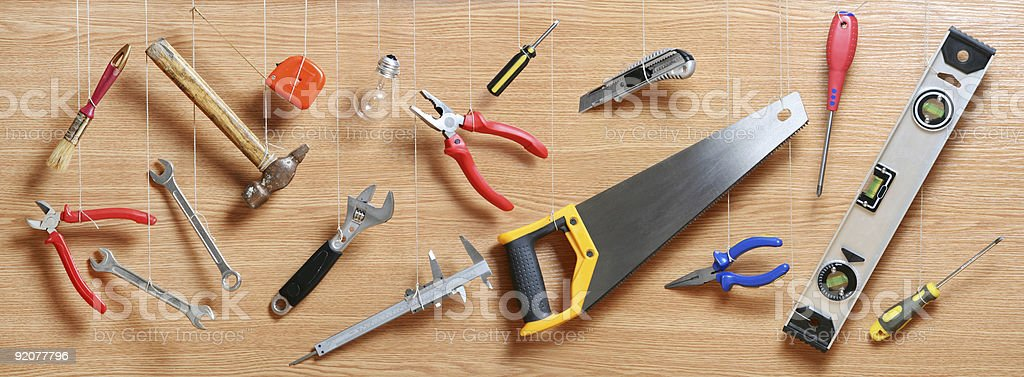 Tools hanging on a rope stock photo