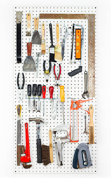 Tools hanging On An Organized pegboard stock photo