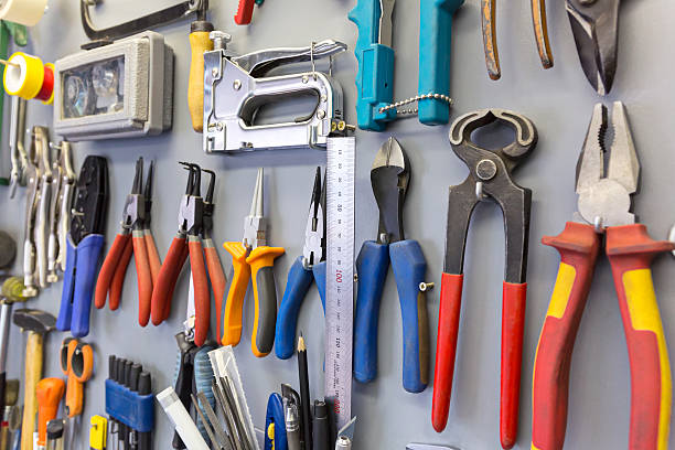 Tools hanging on the board stock photo