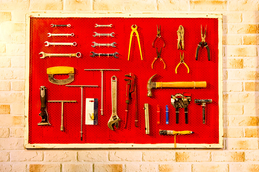Tools hanging on the red panel.