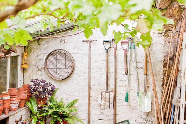 Tools hanging on wall of garden shed  shed stock pictures, royalty-free photos & images