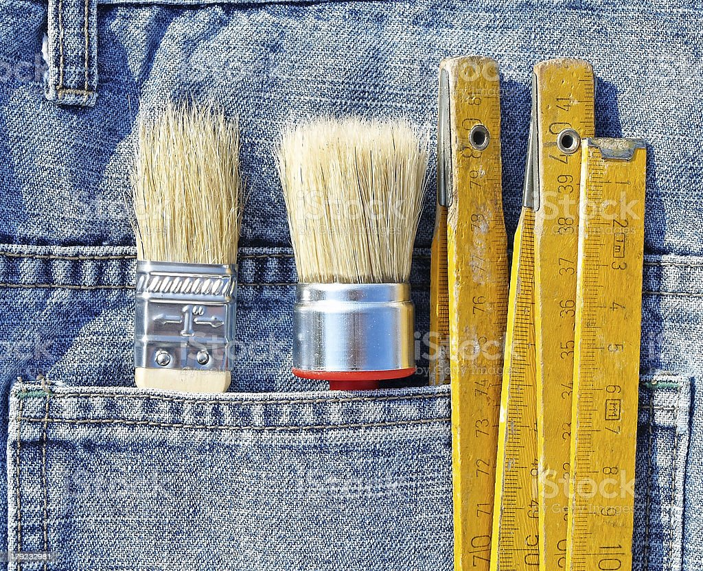Tools in jeans pocket stock photo