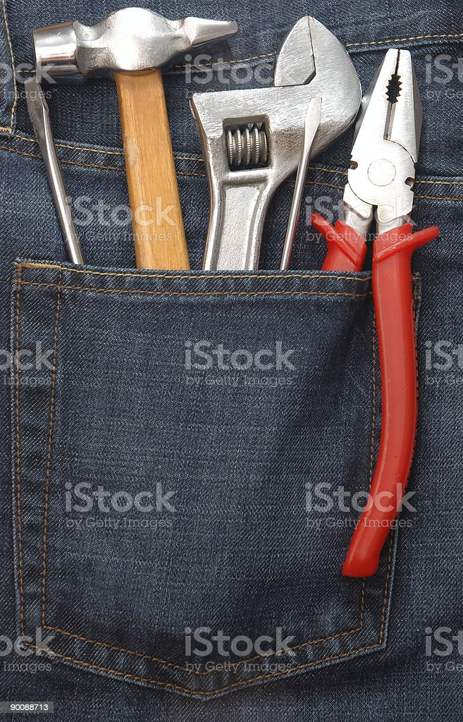 Tools in jeans pocket royalty-free stock photo