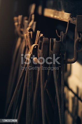 Shot of various blacksmith tools at a foundry