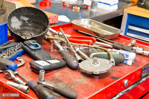 1155772265 istock photo Tools on a workbench in a car repair shop 674749958