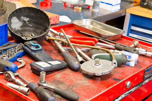 Tools on a workbench in a car repair shop