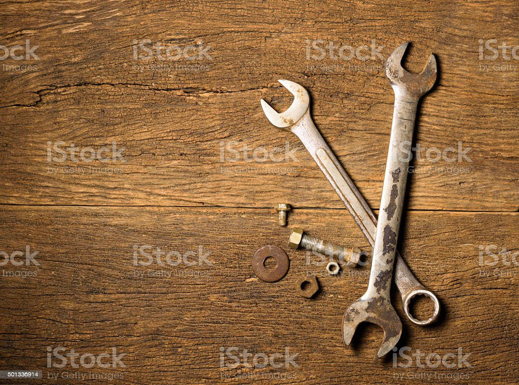 Tools on wooden background. stock photo