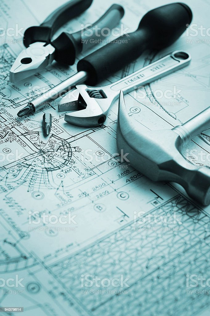 tools over blueprints drawn by hand royalty-free stock photo