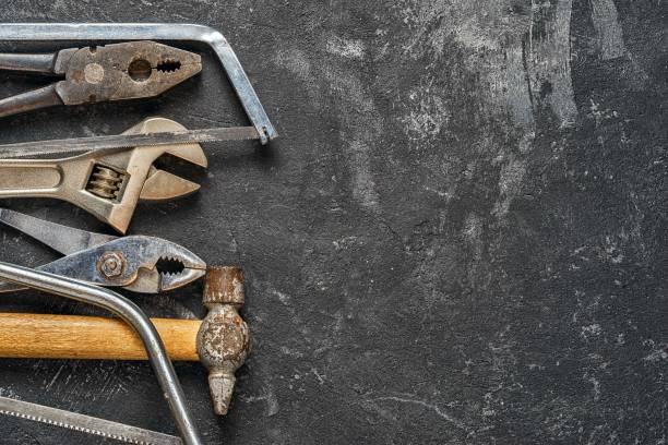 Tools Set of tools on dark cement background with copy space. Suitable as fathers day card. workbench stock pictures, royalty-free photos & images