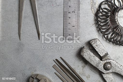 istock Tools set of jewellery. Jewelry workplace on metal background 521616422