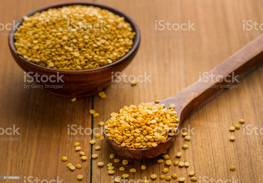 toor dal or arhar dal or raw pulses toor dal or arhar dal or raw pulses in wooden spoon and bowl Asia Stock Photo