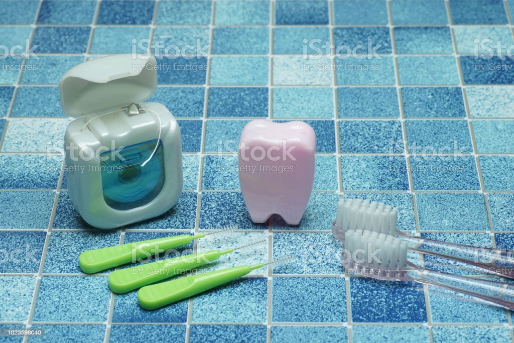 Tooth and brushand dental floss stock photo