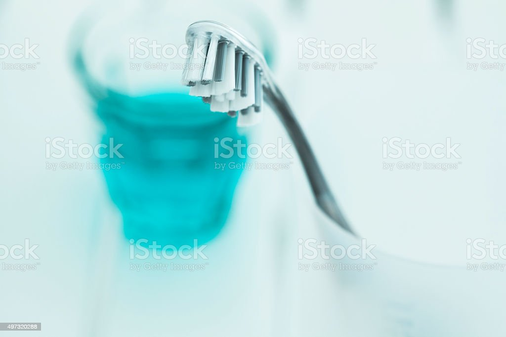 Tooth brush in glass and mouthwash stock photo