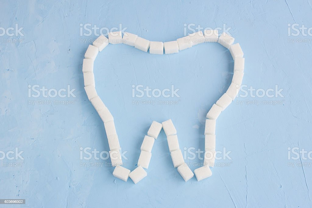 Tooth From Sugar Cubes On Blue Background Symbol Stock Photo More
