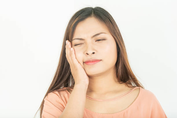 Toothache and root canal problems Swollen gums and pain stock photo
